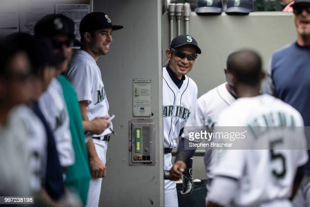 Ichiro Suzuki of the Seattle Mariners jokes with teammates from the entrance of the clubhouse before a game against the Colorado Rockies at Safeco...