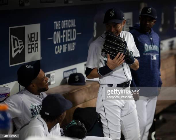 Ichiro Suzuki of the Seattle Mariners jokes with teammates Robinson Cano and Dee Gordon game at Safeco Field on April 14 2018 in Seattle Washington...