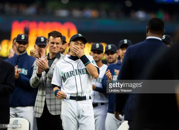 Ichiro Suzuki of the Seattle Mariners laughs as Ken Griffey Jr and Edgar Martinez greet him before receiving the Seattle Mariners Franchise...