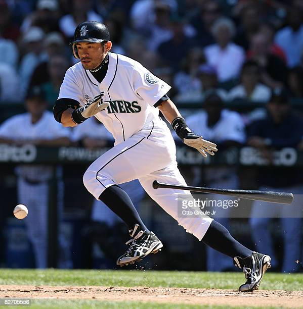 Ichiro Suzuki of the Seattle Mariners lays down an infield bunt single in the fifth inning against the New York Yankees on September 7 2008 at Safeco...