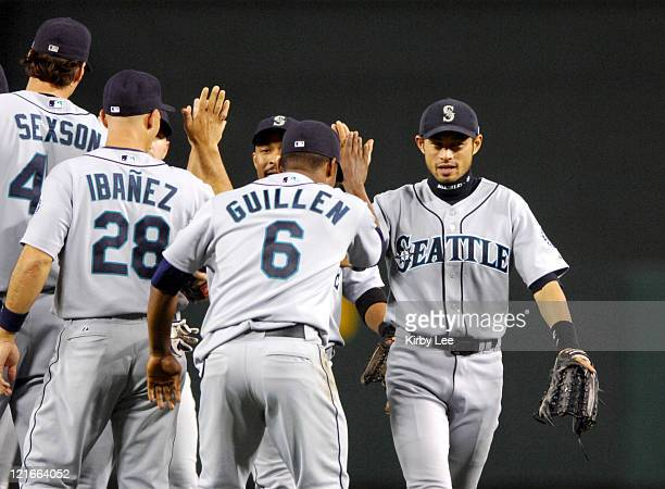 Ichiro Suzuki of the Seattle Mariners left is congratulated by Jose Guillen after 125 victory over the Los Angeles Angels of Anaheim in Major League...