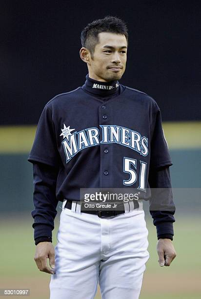 Ichiro Suzuki of the Seattle Mariners looks on as he is presented the MLB Historic Achievement Award by MLB Commissioner Bud Selig for breaking the...