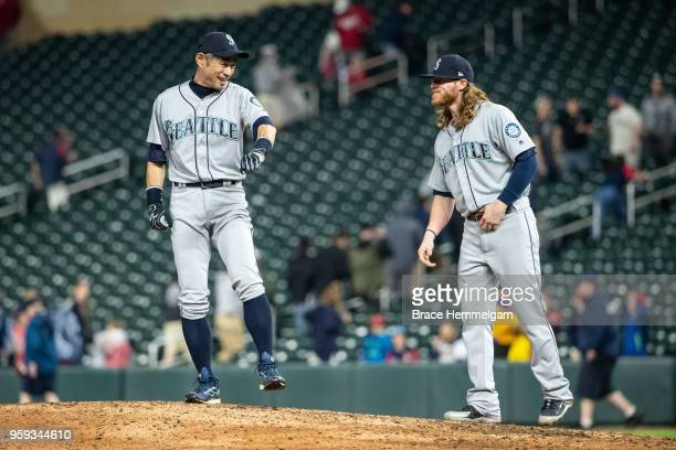 Ichiro Suzuki of the Seattle Mariners looks on with Ben Gamel against the Minnesota Twins on May 14 2018 at Target Field in Minneapolis Minnesota The...