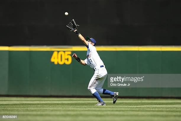 Ichiro Suzuki of the Seattle Mariners makes a catch against the Cleveland Indians on July 19, 2008 at Safeco Field in Seattle, Washington.