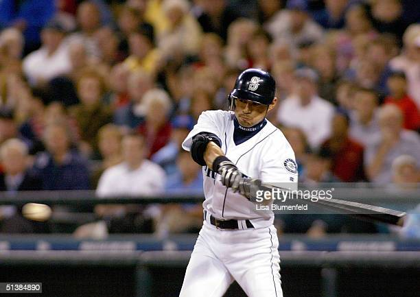 Ichiro Suzuki of the Seattle Mariners makes his 260th hit of the season in the 5th inning against the Texas Rangers on October 2 2004 at Safeco Field...