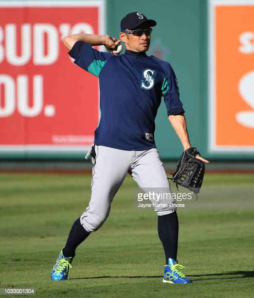 Ichiro Suzuki of the Seattle Mariners plays catch in the outfield before the game against the Los Angeles Angels of Anaheim at Angel Stadium on...