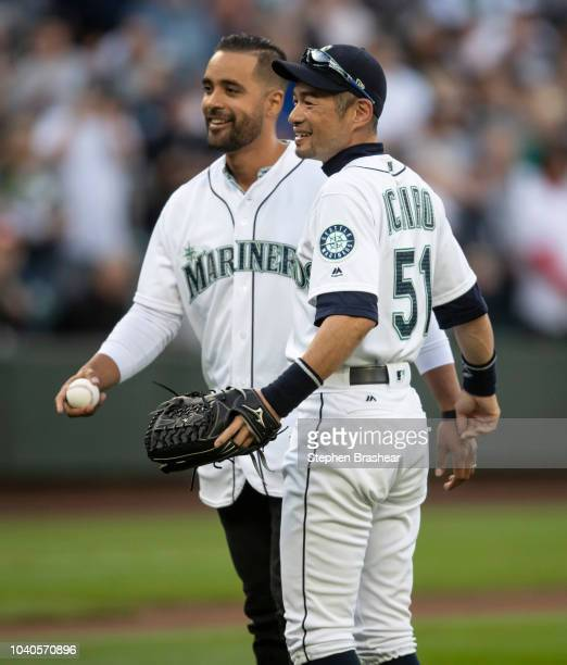 Ichiro Suzuki of the Seattle Mariners poses for a photo with Franklin Guiterrez after the ceremonial first pitch before a game against the New York...