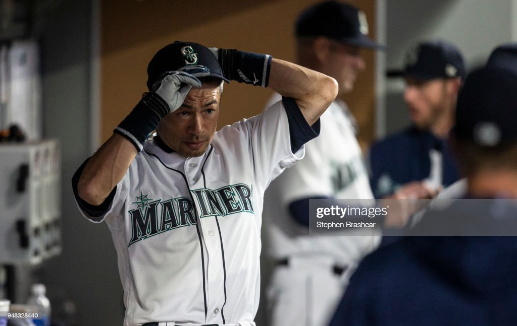 3a3f557a7 Ichiro Suzuki of the Seattle Mariners puts on his cap before a game ...