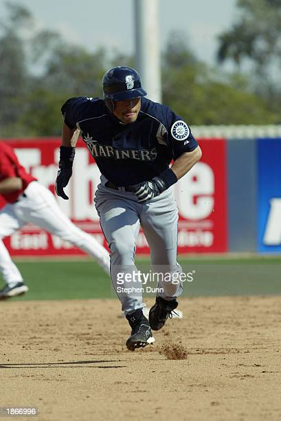 Ichiro Suzuki of the Seattle Mariners runs the bases against the Anaheim Angels in a spring training game on March 5 2003 at Tempe Diablo Stadium in...