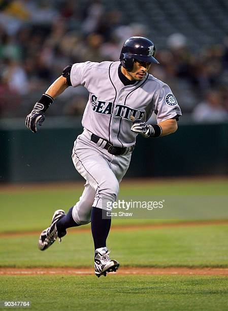Ichiro Suzuki of the Seattle Mariners runs to first base after hitting a single that scored Kenji Johjima to give the Mariners a 30 in the second...