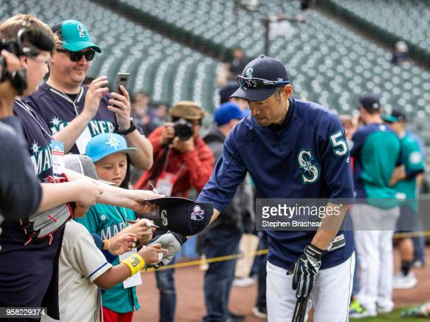 Ichiro Suzuki of the Seattle Mariners signs autographs for fans before a game against the Los Angeles Angels of Anaheim at Safeco Field on May 5 2018...