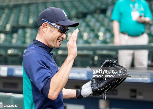 Ichiro Suzuki of the Seattle Mariners smacks his glove before a game against the New York Yankees at Safeco Field on September 7 2018 in Seattle...