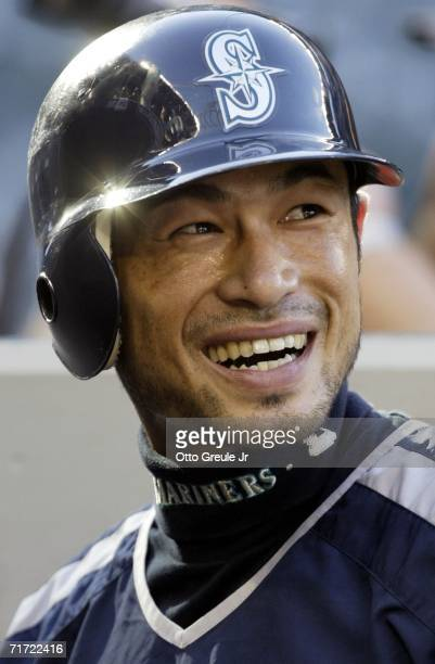 Ichiro Suzuki of the Seattle Mariners smiles while signing autographs prior to the game against the Boston Red Sox on August 26 2006 at Safeco Field...