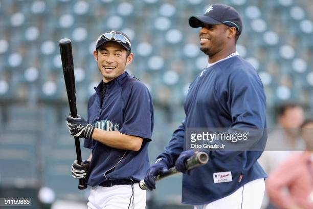 Ichiro Suzuki of the Seattle Mariners smiles with Ken Griffey Jr #24 during practice before the game against the New York Yankees on September 18...
