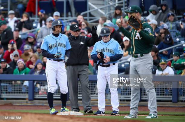 Ichiro Suzuki of the Seattle Mariners stands at first base after hitting a RBI single against the Oakland Athletics during the third inning of the...
