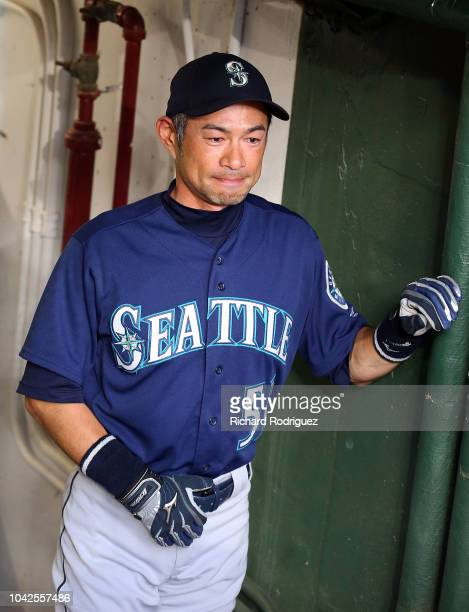 Ichiro Suzuki of the Seattle Mariners stands in the dugout before the game between the Seattle Mariners and Texas Rangers at Globe Life Park in...