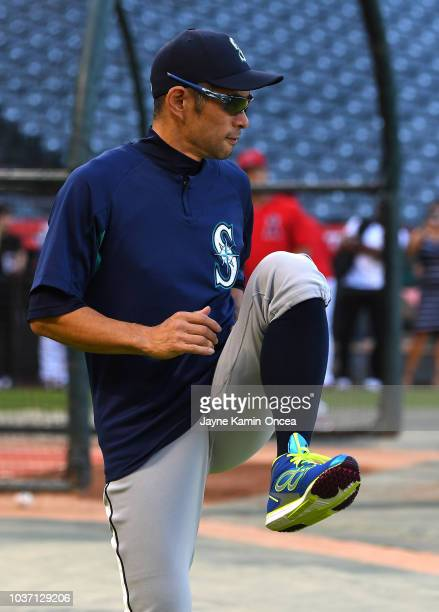 Ichiro Suzuki of the Seattle Mariners stretches with roster players before the game against the Los Angeles Angels of Anaheim at Angel Stadium on...