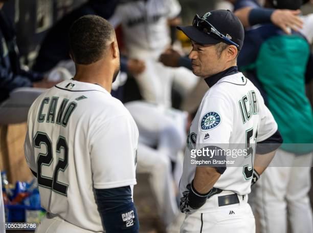Ichiro Suzuki of the Seattle Mariners talks with Robinson Cano of the Seattle Mariners before a game against the Texas Rangers at Safeco Field on...