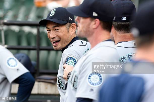 Ichiro Suzuki of the Seattle Mariners talks with teammates in the dugout before the game against the Baltimore Orioles at Oriole Park at Camden Yards...