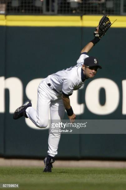 Ichiro Suzuki of the Seattle Mariners throws out Vladimir Guerrero of the Los Angeles Angels of Anaheim at home in the fifth inning on May 4 2005 at...