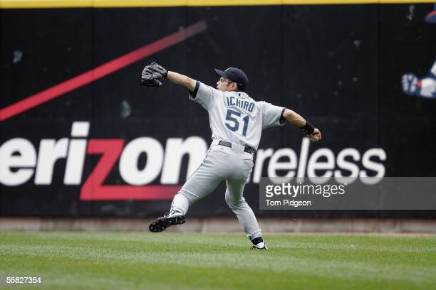 Ichiro Suzuki of the Seattle Mariners throws the ball from the outfield during the game against the Detroit Tigers at Comerica Park on September 25...
