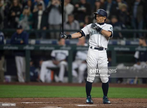 Ichiro Suzuki of the Seattle Mariners waits for a pitch from starting pitcher Corey Kluber of the Cleveland Indians during the third inning of a game...