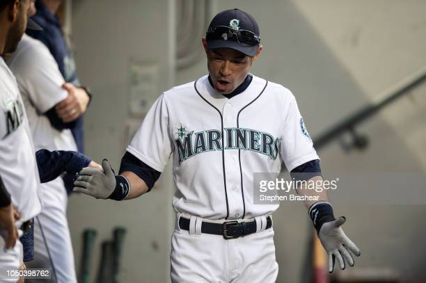 Ichiro Suzuki of the Seattle Mariners walks through the dugout before a game against the Texas Rangers at Safeco Field on September 29 2018 in...