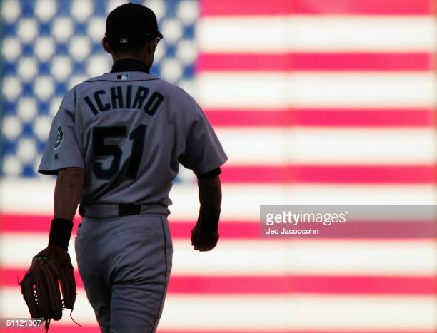 Ichiro Suzuki of the Seattle Mariners walks to right field in the first inning against the Oakland Athletics at a MLB game at the Network Associates...