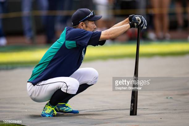 Ichiro Suzuki of the Seattle Mariners warms up before taking batting practice before a game against the Los Angeles Dodgers at Safeco Field on August...