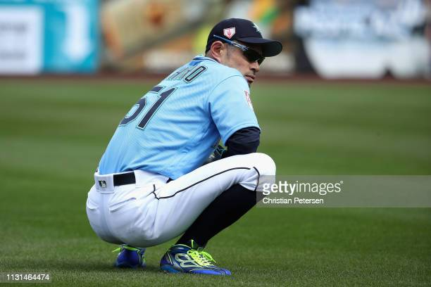 Ichiro Suzuki of the Seattle Mariners warms up before the MLB spring training game against the Oakland Athletics at Peoria Stadium on February 22...