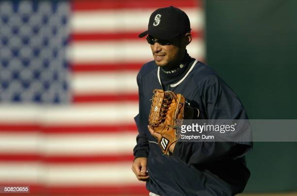 Ichiro Suzuki of the Seattle Mariners warms up prior to the game against the Oakland A's on April 9 2004 at Network Associates Coliseum in Oakland...