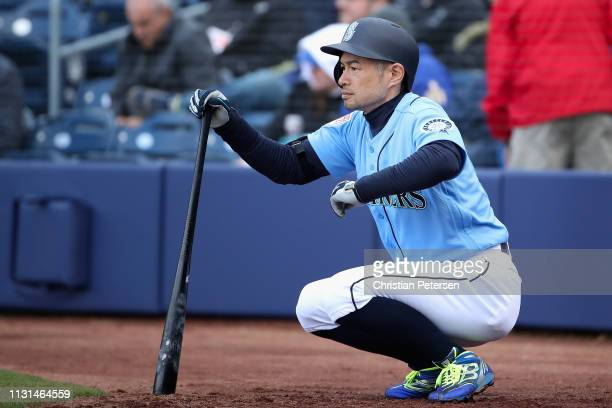 Ichiro Suzuki of the Seattle Mariners warmsup on deck during the third inning of the MLB spring training game against the Oakland Athletics at Peoria...