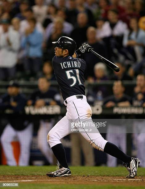 Ichiro Suzuki of the Seattle Mariners watches his game winning tworun homer in the bottom of the ninth inning to defeat the New York Yankees 32 on...