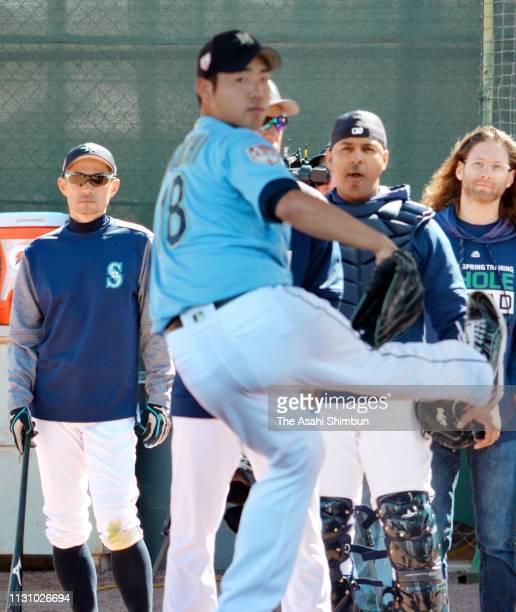 Ichiro Suzuki of the Seattle Mariners watches Yusei Kikuchi throwing in the bullpen during the spring training on February 19 2019 in Peoria Arizona