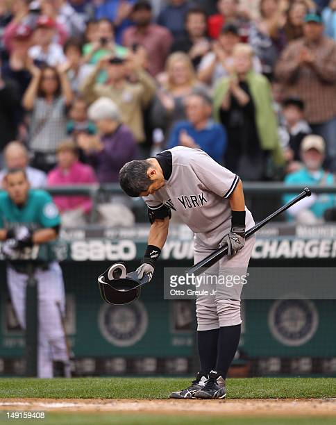 Ichiro Suzuki of the the New York Yankees bows to the crowd in his first atbat against the Seattle Mariners at Safeco Field on July 23 2012 in...