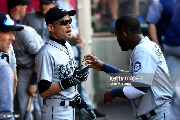 Ichiro Suzuki talks with Guillermo Heredia of the Seattle Mariners prior to a game against the Los Angeles Angels of Anaheim at Angel Stadium on July...
