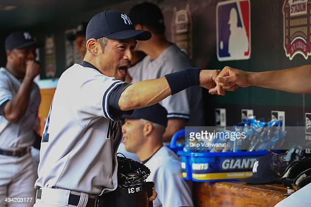 Ichiro Suzuki the New York Yankees greets teammates prior to playing against the St Louis Cardinals at Busch Stadium on May 28 2014 in St Louis...