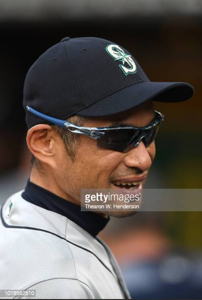 Ichiro Suzuki the Special Assistant to the Chairman of the Seattle Mariners in the dugout laughing prior to the start of the game against the Oakland...