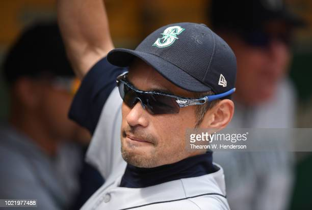 Ichiro Suzuki the Special Assistant to the Chairman of the Seattle Mariners looks on from the dugout prior to the start of their game against the...