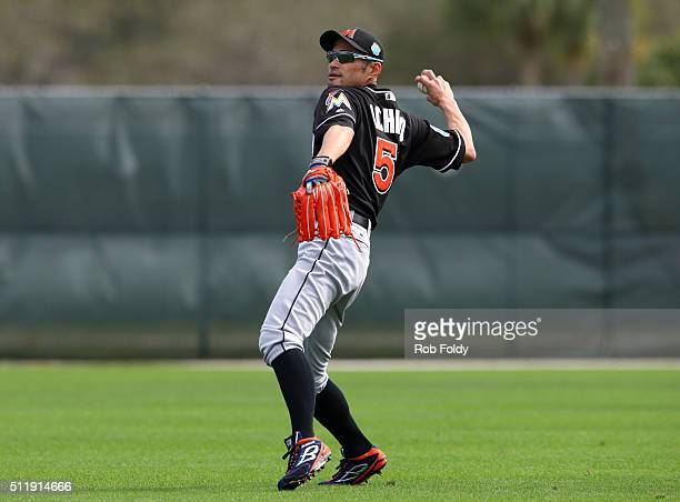 Ichiro Suzuki throws during a Miami Marlins workout on February 23 2016 in Jupiter Florida