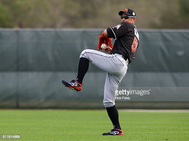 Ichiro Suzuki throws during a Miami Marlins workout on February 23 2016 in Jupiter Florida