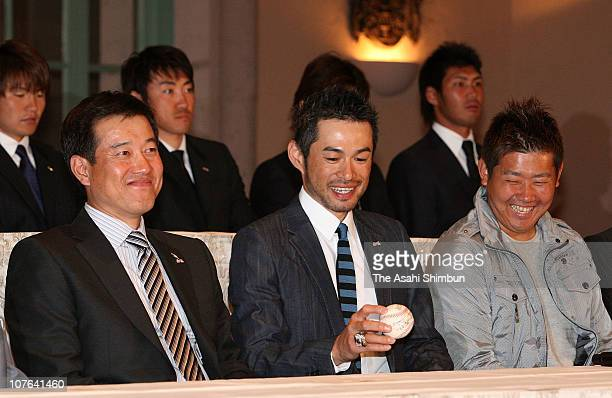 Ichiro Suzuki watches the winning ball while head coach Tatsunori Hara and pitcher Daisuke Matsuzaka smile during the press conference held a day...