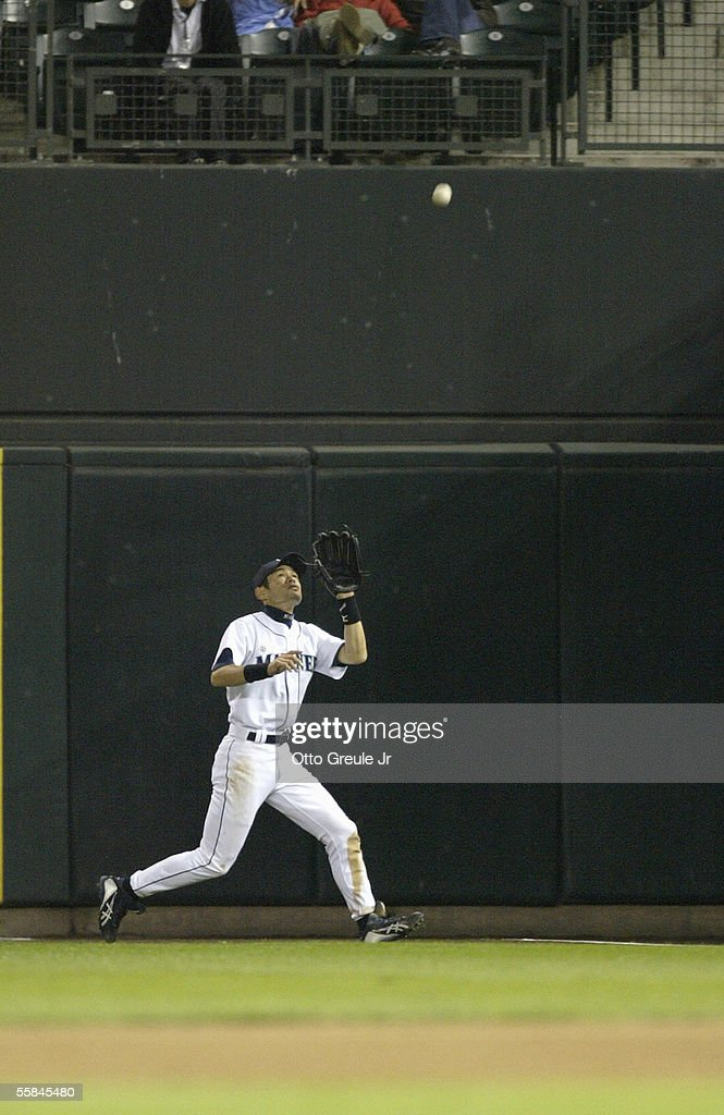 Ichiro Suzuki#51 of the Seattle Mariners moves back to catch the flyball during the game against the Texas Rangers on September 28 2005 at Safeco Field in Seattle Washington. The Rangers won 7-3.