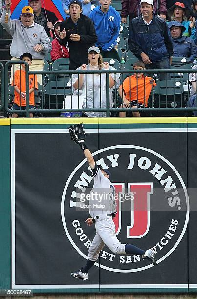 Ichrio Suzuki of the New York Yankees makes the catch on Austin Jackson of the Detroit Tigers deep fly ball to right field in the eighth inning...