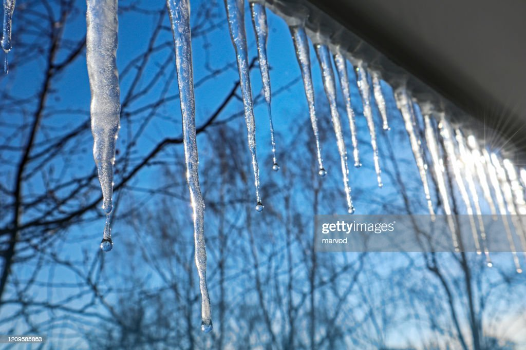 Icicles against the blue sky. : Stock Photo