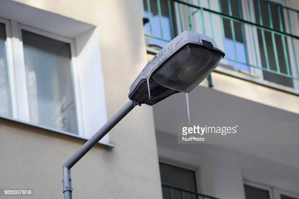 Icicles are seen hanging from a street light in Warsaw Poland on March 17 2018