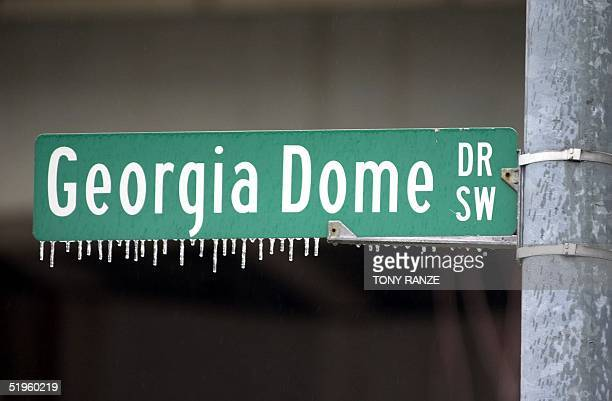 Icicles clings from a street sign in front of the Georgia Dome after an ice storm in the Atlanta area early 29 January 2000 The St Louis Rams will...