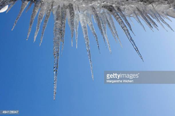Icicles dangle from the gutter on a building on February 25 2013 in Walchensee Germany