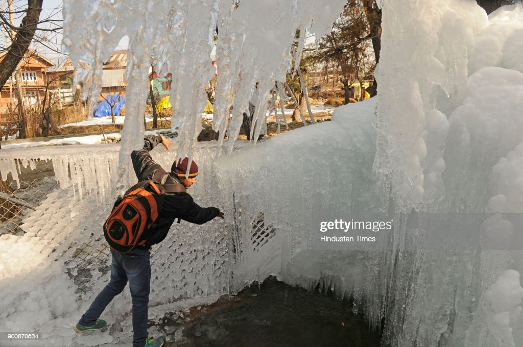Icicles formed by the leakage of a water pipe are seen on January 3, 2018 in Tanmarg, about 34 kms North of Srinagar, India. The weather in the region continued to remain dry even as the valley remains in a grip of cold wave with temperature in the night dropping to below freezing point.