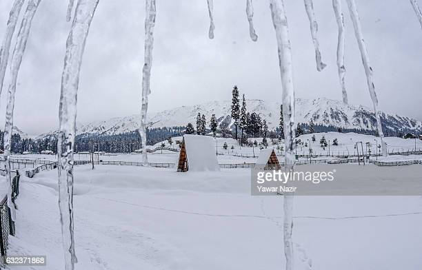 Icicles hang from a roof top after seasons first snowfall on January 22 2017 in Gulmarg to the west of Srinagar the summer capital of...